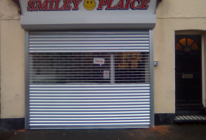 White Perforated Roller Shutters