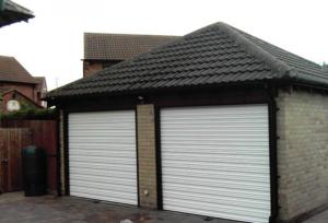 White Steel Shutters on Garage Door